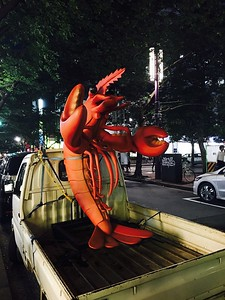 Lobster tied to the back of a mini truck, Yaesu