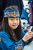 A young Japanese girl demonstrating oragami in Kushiro city, Subprefecture, Hokkaido, Japan