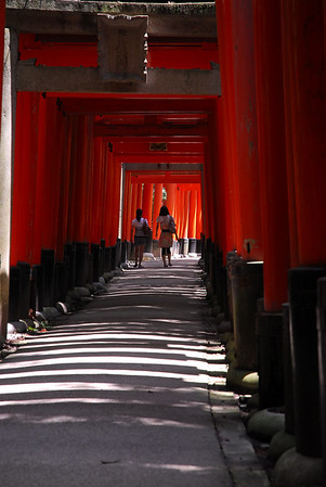 Fushimi Inari Shrine is famous for the countless torii gates, offerings by worshippers, that cover the hiking trails thru Inari-san, the wooded mountain behind the shrine's main buildings. It takes about two hours to walk along the whole trail.