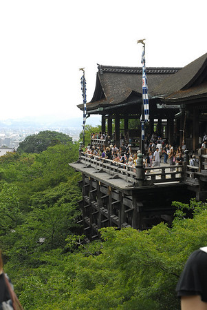 The main hall has a large veranda, supported by tall pillars, that juts out over the hillside and offers impressive views of the city. It takes its name from the waterfall within the complex, which runs off the nearby hills. Kiyomizu means clear water, or pure water. Visitors can catch and drink the waters, which is believed to have therapeutic properties. Drinking the water of the three streams is said to confer wisdom, health, and longevity.