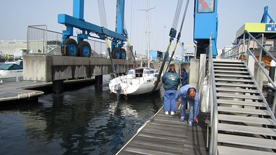 Crane picks up boat