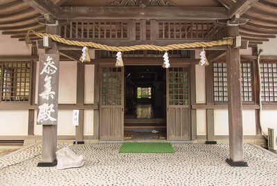 View into aand through and annex house of the shrine.