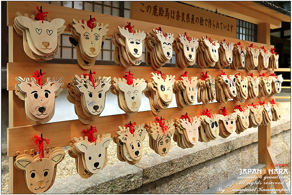 Cute wooden wishing plaques (Ema) at the shrine