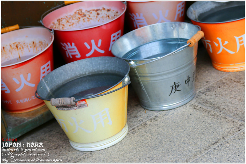 Metal buckets filled with water in case of fire