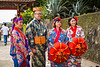 People in ethnic dress at the Shurijo Castle in Naha, Okinawa, Japan.