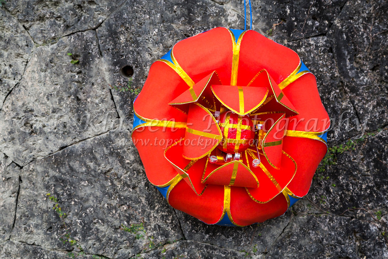 A decorative Japanese wreath on a stone wall at the Shurijo Castle in Naha, Okinawa, Japan.