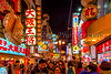 Street life in Dotonbori at night in Osaka, Japan, Asia.