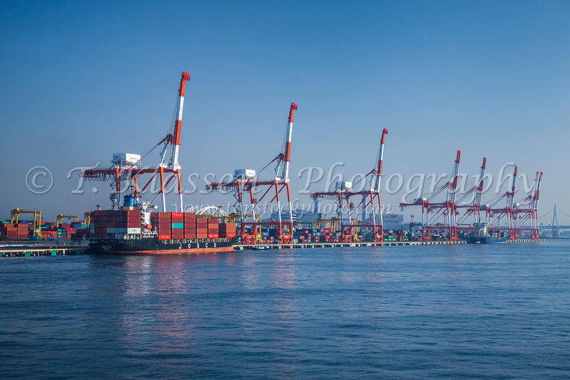 Cargo cranes at the container port of Osaka, Japan.