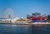 The Tempozan Bridge, ferris wheel and aquarium building in the port of Osaka, Japan.
