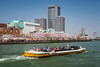A sightseeing tour boat on the Okawa River near The Mint in Osaka, Japan.