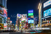 The bright lights of Shibuya Crossing at night in the Shibuya district of Tokyo, Japan, Asia.