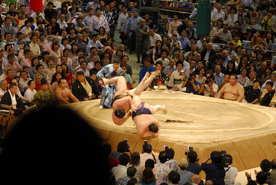But once Hakuho locked in on his opponent's mawashi, he sent the No. 3 maegashira sailing over the edge with a powerful left hand as both men took off into the air.