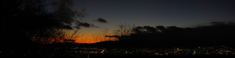 Kyoto Sunset  Shot handheld at 1/50th f/2 at ISO 400 with the 50mm AF-S G and stitched with the excellent Windows Live Photo Gallery.  (C) 2009 Brian Neal