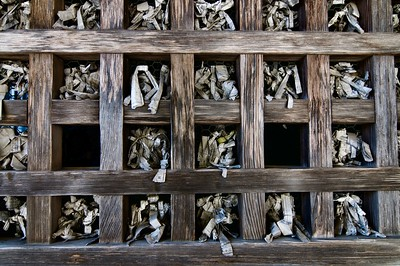 Old omikuji おみくじ stored in pigeon holes
