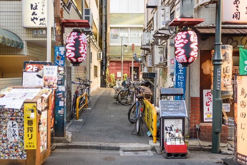 Fixing a Bike in an Alley
