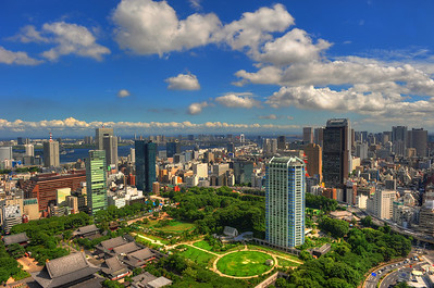 (C) 2010 Brian Neal  The Tokyo skyline, looking Southeast towards Tokyo Bay, with the Rainbow Bridge visible in the distance.