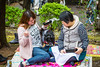 Japanese people having a picnic in Ueno Onshi Park, Taito, Tokyo, Japan, Asia.