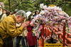 Cherry blossoms and Japanese worshipers at a Buddhist shrine in Ueno Onshi Park, Taito, Tokyo, Japan, Asia.