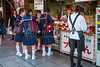 Japanese school girls sampling street food in Chinatown, Yokohama, Japan, Asia.