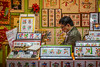 A male shop keeper  and shop interior in Chinatown, Yokohama, Japan, Asia.