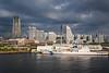 Boats in the harbor and city skyline at the port city of Yokohama, Japan, Asia.