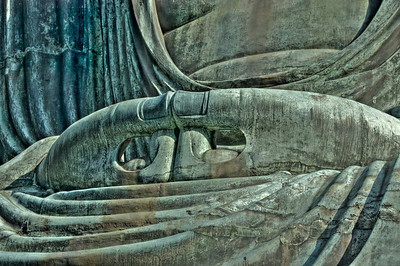Close up of buddha's hand. HDR. Daibutsu or Big Buddha temple in Kamakura. Japan.