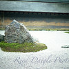 Ryoanji Zen Rock Garden in Kyoto, Japan with large stone prominent