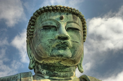 Close up of buddha's face. HDR. Daibutsu or Big Buddha temple in Kamakura. Japan.
