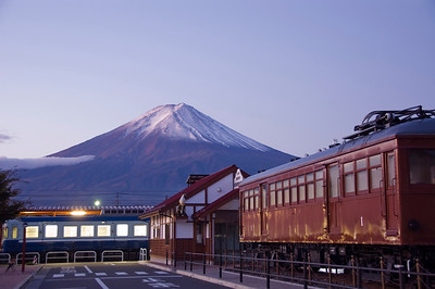 Mt Fuji at dawn and the Train Station. Train Station and Mt Fuji in the background at dawn.