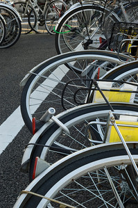 Close up of many bicycles parked at a lot in Japan.