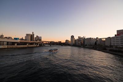 Water Taxi Heading Down the Sumida River Towards Tokyo Bay