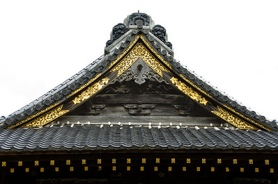 Buddhist roof with golden ornaments and wood carved decorations isolated on white. Narita San Temple near Tokyo, Japan.