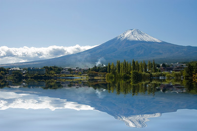 Mt Fuji on a clear day reflecting on a lake. Kawaguchi. Japan