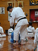 Matsuda sensei holds the stick to be sure each student sits up straight.