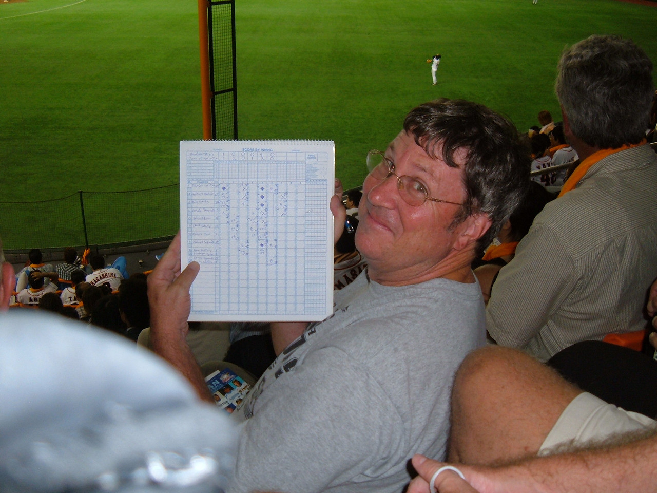 Hall of Famer Bob Abels keeping score, a rare sight at a Japanese park.