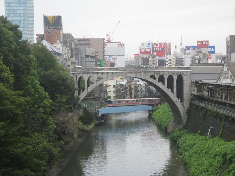 Train crossing bridge in Tokyo