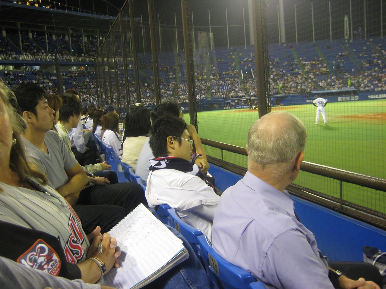Japanese fan sleeping during game