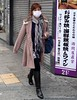 Fashionably dressed woman with a face mask in Osaka, Japan in March 2015