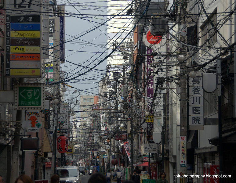 A busy street with lots of cables in Osaka, Japan in March 2015