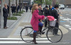 A woman with high heeled boots on a bicycle in Osaka, Japan in March 2015