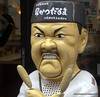An angry looking chef outside a restaurant in Osaka, Japan in March 2015