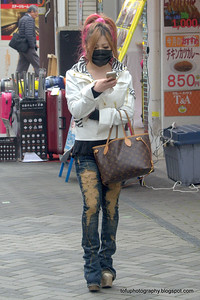 Fashionable young woman in Osaka, Japan in March 2015