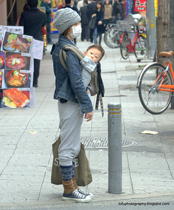 A woman with her baby in Osaka, Japan in March 2015