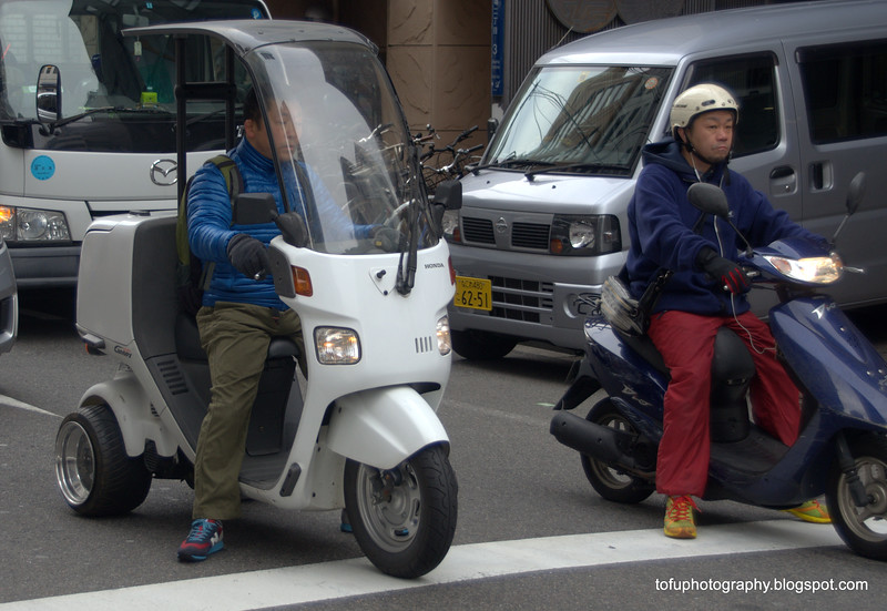 An electric three wheeled scooter in Osaka, Japan in March 2015