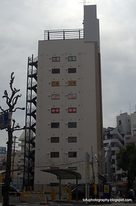 An apartment block with external fire escapes in Osaka, Japan in March 2015