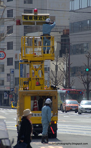 Fixing traffic signals in Nagasaki, Japan in March 2015