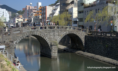 Stone bridge, known as the Spectacle Bridge over the Nagashima River in Nagasaki, Japan in March 2015