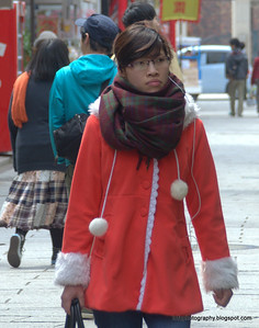 A woman wearing what appears to be a Xmas jacket in Nagasaki, Japan in March 2015