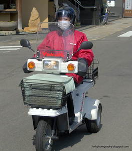 Woman on an electric scooter in Nagasaki, Japan in March 2015