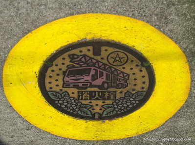 A painted manhole cover on a street in Nagasaki, Japan in March 2015